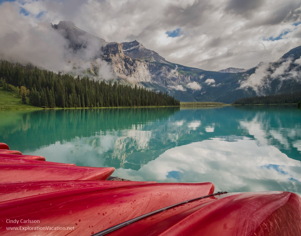 lake, mountains and canoes