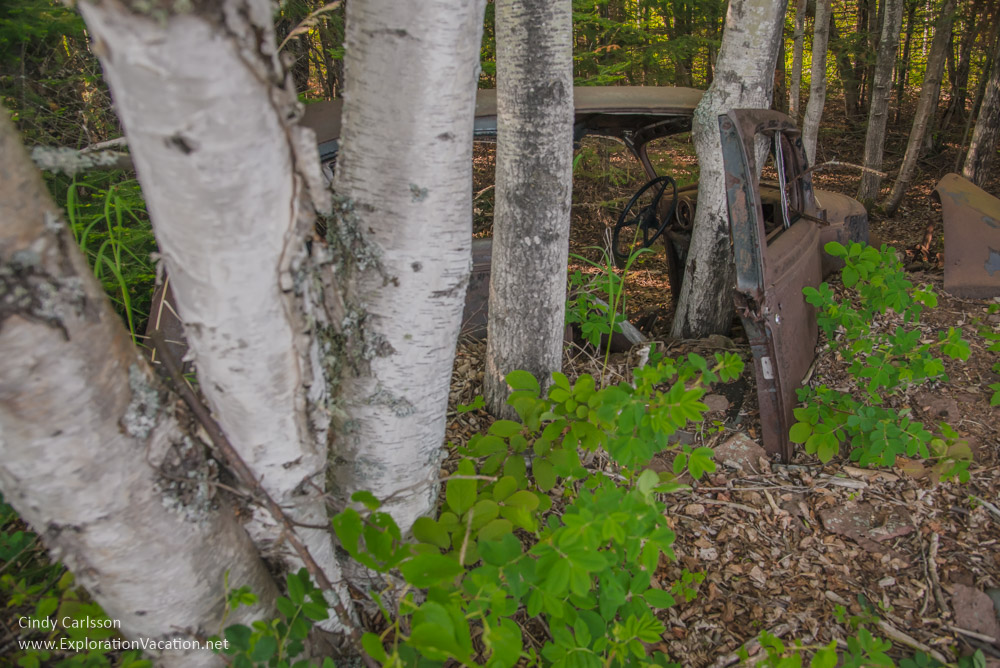 old car in the woods along Lake Superior