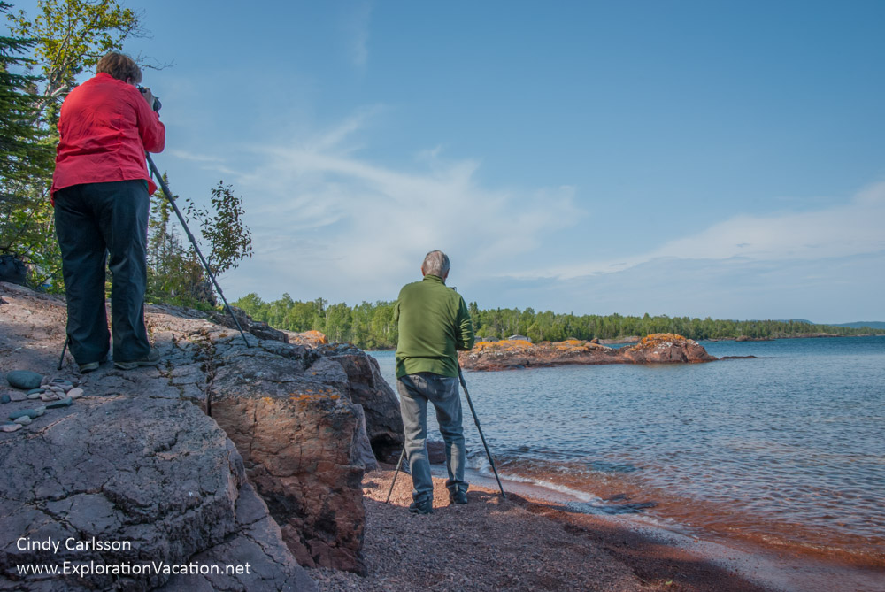 photographers on rocky outcropping along Lake Superior