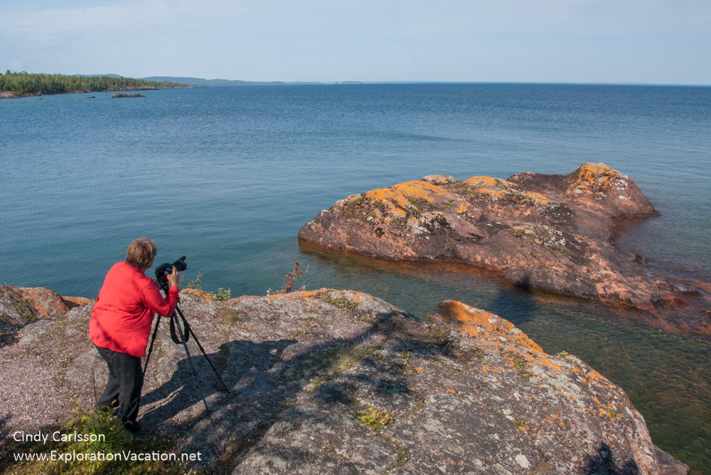 photographer on rocky outcropping along Lake Superior