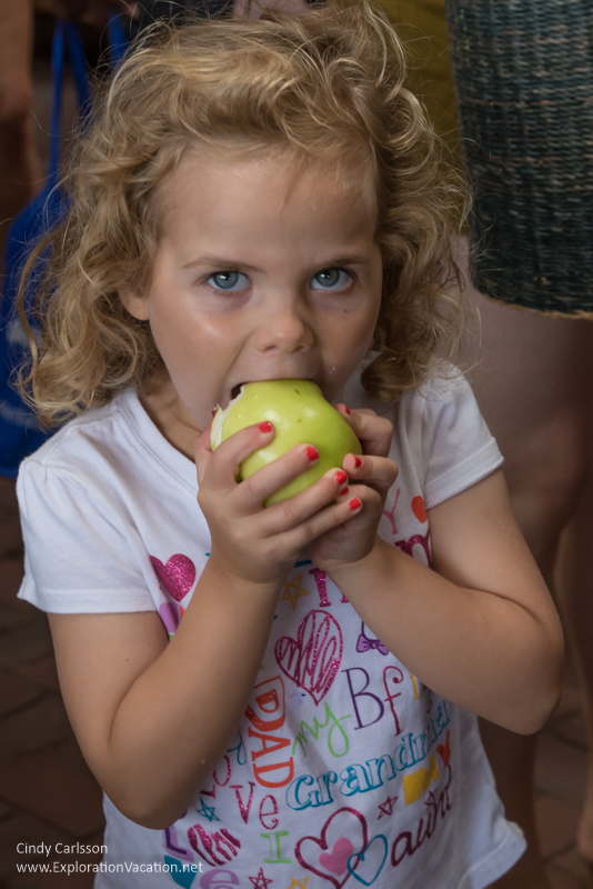 eating an apple at the Saint Paul farmers market